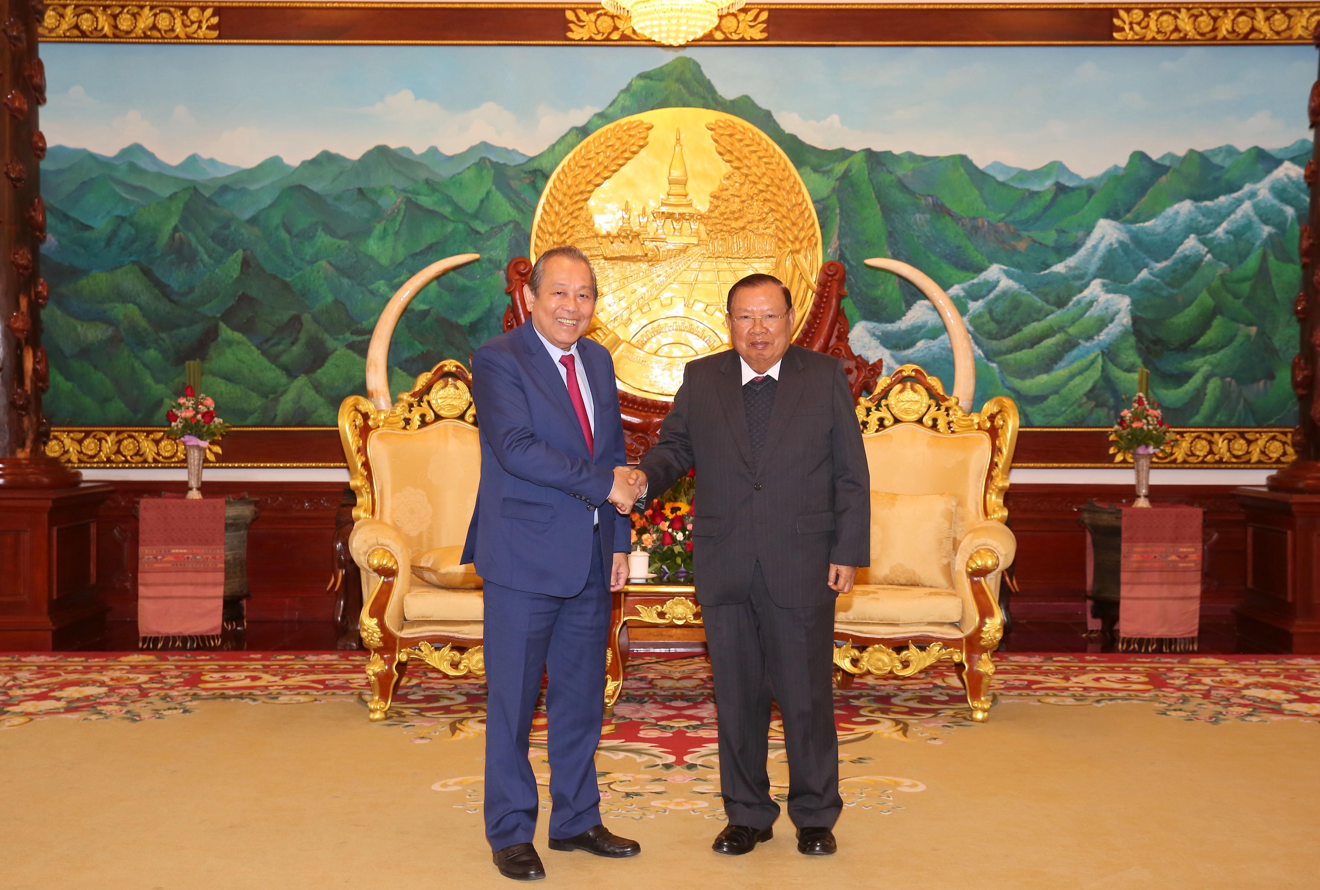 Phó Thủ tướng Thường trực Chính phủ Trương Hòa Bình hội kiến Tổng Bí thư, Chủ tịch nước Lào Bounnhang Vorachith. Ảnh: Lê Sơn