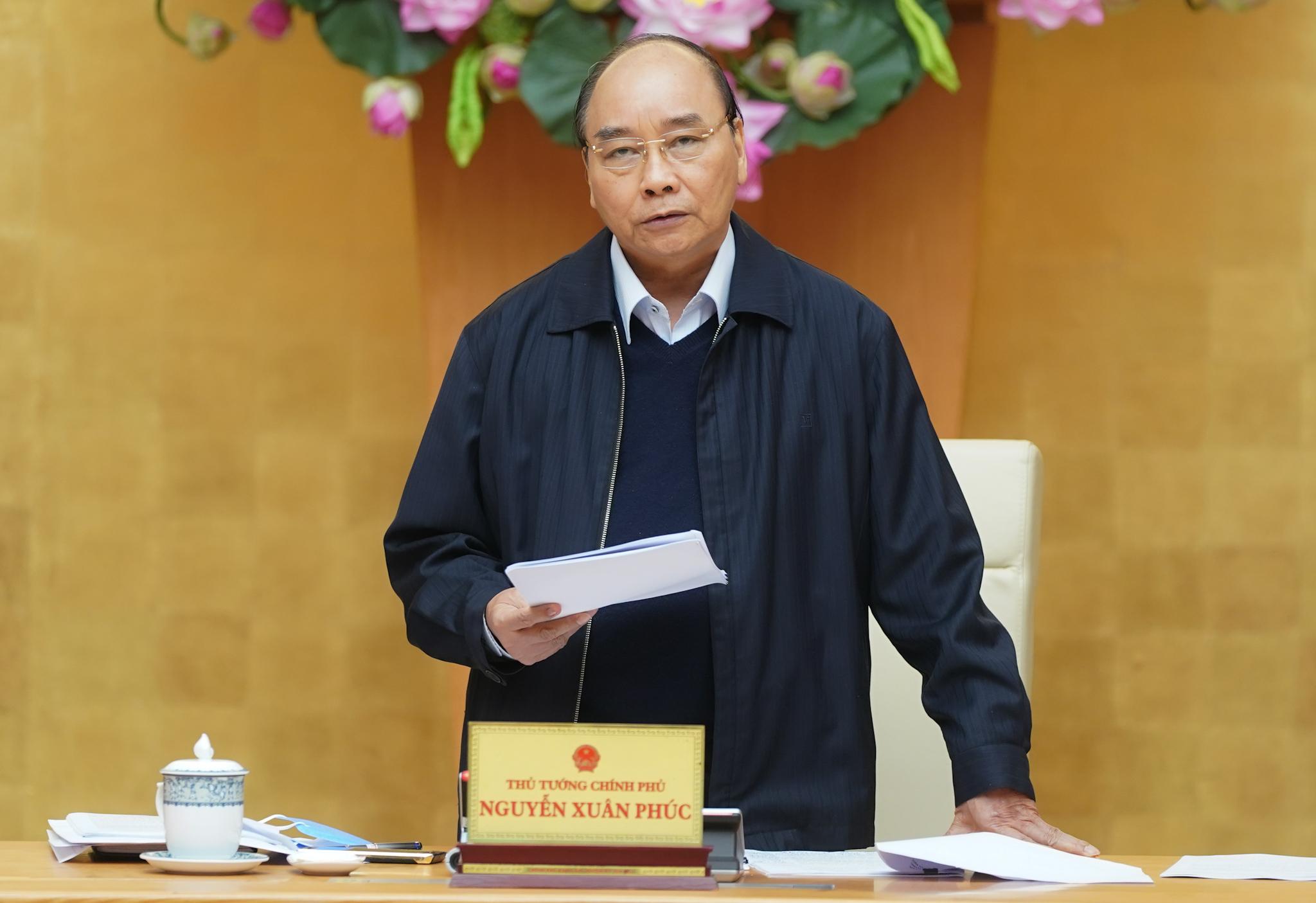 Thủ tướng Nguyễn Xuân Phúc yêu cầu việc chi trả hỗ trợ phải thuận lợi cho người lao động, người gặp khó khăn. Ảnh: VGP/Quang Hiếu