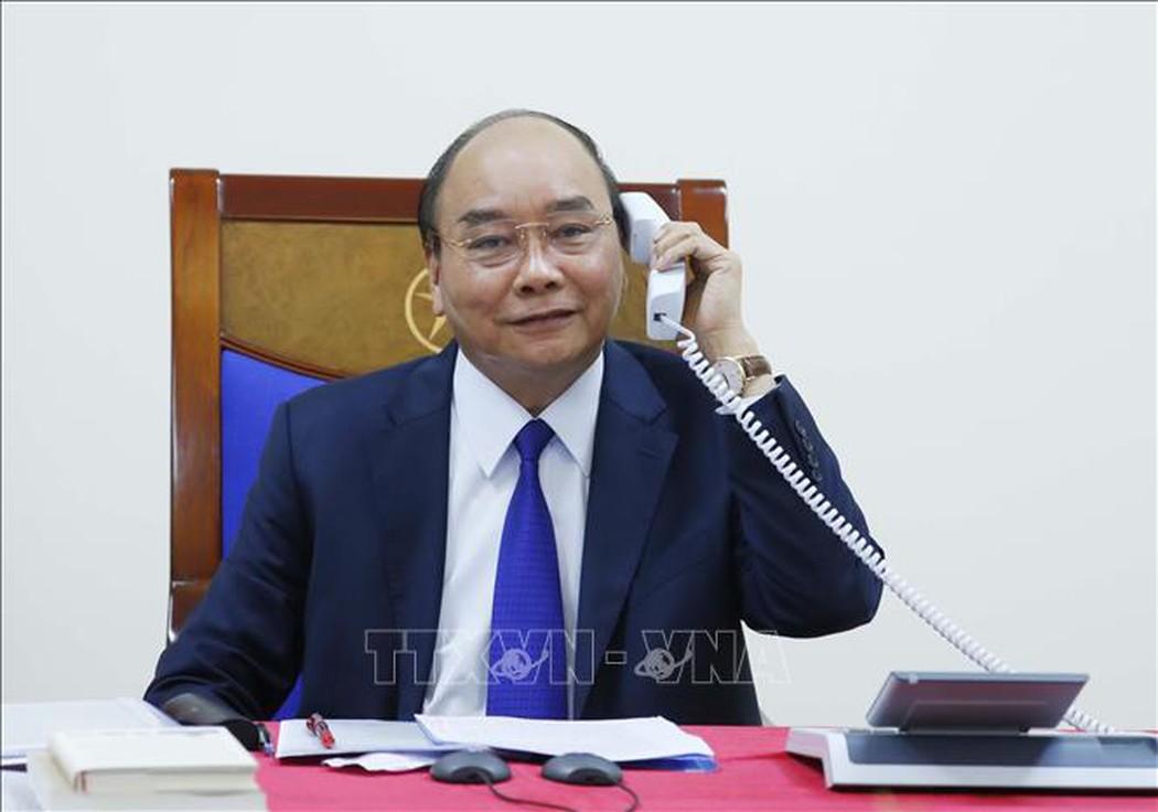 Thủ tướng Nguyễn Xuân Phúc điện đàm với Tổng thống Hoa Kỳ Donald Trump về tình hình phòng, chống dịch COVID-19. Ảnh: Thống Nhất/TTXVN