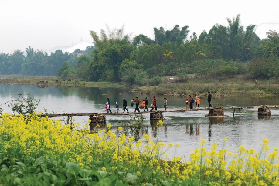 Cầu nối đôi bờ sông Kỳ Cùng ở xã Tân Liên, huyện Cao Lộc (Lạng Sơn) - Ảnh Dương Bao