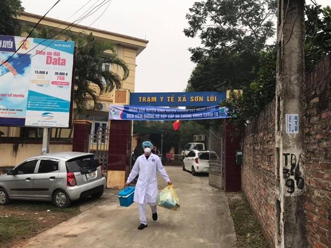 Cán bộ điều tra dịch tễ xuống làm việc, thực hiện chống dịch Covid-19 tại xã Sơn Lôi, huyện Bình Xuyên, Vĩnh Phúc. (Ảnh: K.S.B)
