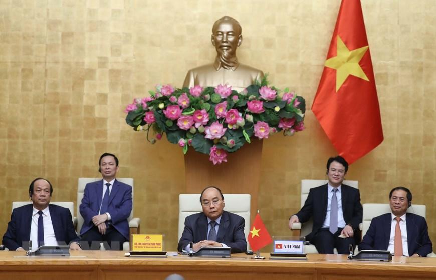 Thủ tướng Nguyễn Xuân Phúc, Chủ tịch ASEAN 2020 và các đại biểu tham dự hội nghị. Ảnh: Thống Nhất/TTXVN