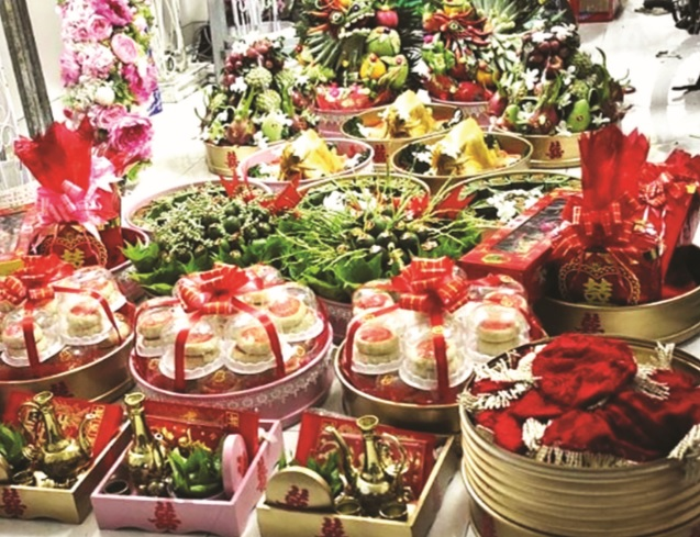Tổ chức nghi lễ cưới hỏi với nhiều lễ vật là hủ tục, gây lãng phí, tốn kém cần phải loại bỏ. (Ảnh minh họa)