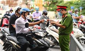 Hà Nội: Người dân ra đường phải xuất trình thêm lịch trực, văn bản phân công nhiệm vụ
