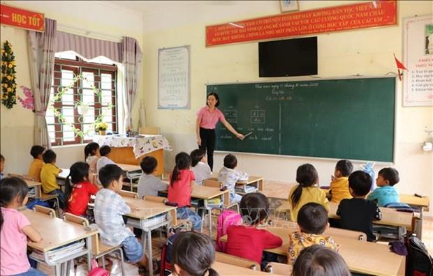 Học sinh lớp 1 Trường Tiểu học và Trung học cơ sở Nậm Loỏng, xã Sùng Phài, thành phố Lai Châu. Ảnh: Đinh Thùy-TTXVN