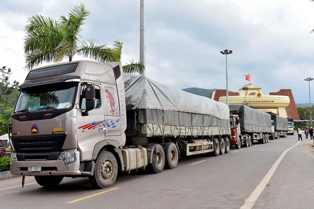 Đoàn xe chở gạo sang Lào. (Nguồn: Bộ Tài chính)