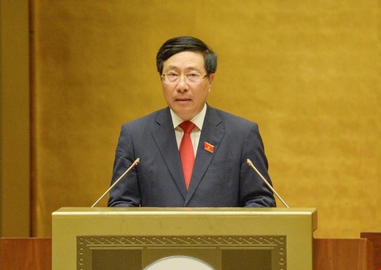Phó Thủ tướng Chính phủ Phạm Bình Minh trình bày báo cáo Đánh giá kết quả thực hiện kế hoạch phát triển KT - XH, ngân sách nhà nước 6 tháng đầu năm và các giải pháp thực hiện kế hoạch phát triển KT - XH, ngân sách nhà nước 6 tháng cuối năm 2021.