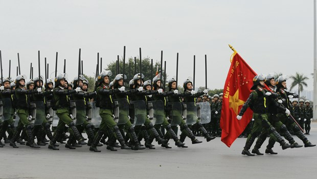 Các lực lượng xuất quân, triển khai các phương án, huy động phương tiện, huấn luyện võ thuật, diễn tập giải quyết các tình huống gây rối, các trường hợp tụ tập kích động tại các mục tiêu được bảo vệ. (Ảnh: Doãn Tấn/TTXVN)
