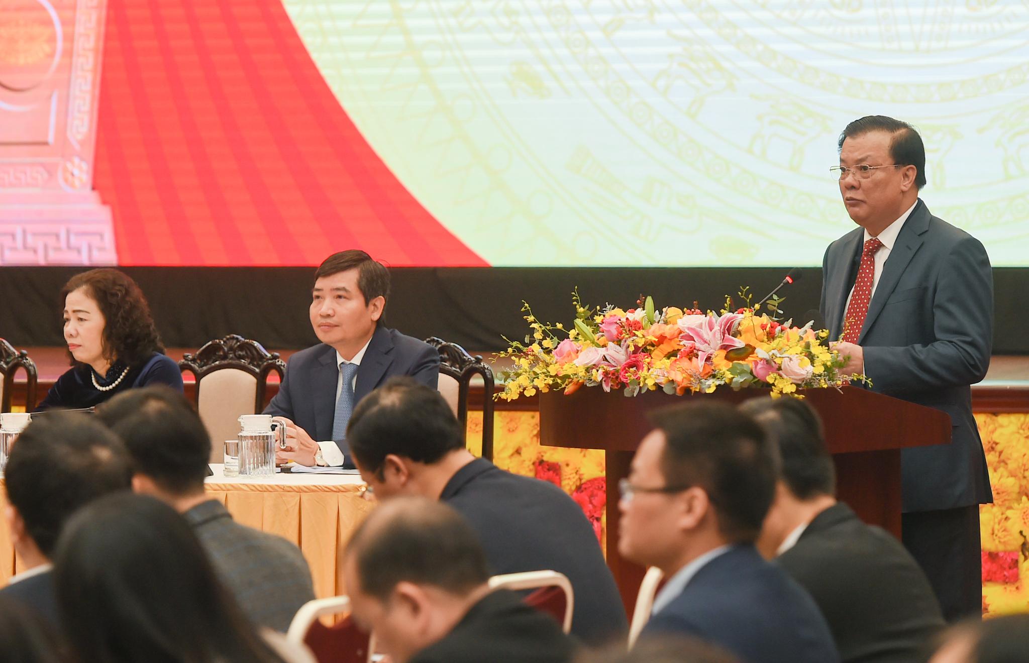 Bộ trưởng Bộ Tài chính Đinh Tiến Dũng trình bày kế hoạch công tác năm 2021 của Bộ Tài chính. Ảnh: VGP/Quang Hiếu