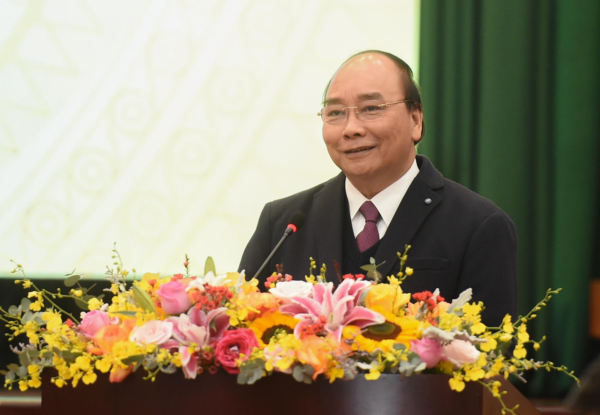 Thủ tướng đề nghị ngành tài chính thực hiện 9 nhiệm vụ trọng tâm trong năm 2021. Ảnh: VGP/Quang Hiếu