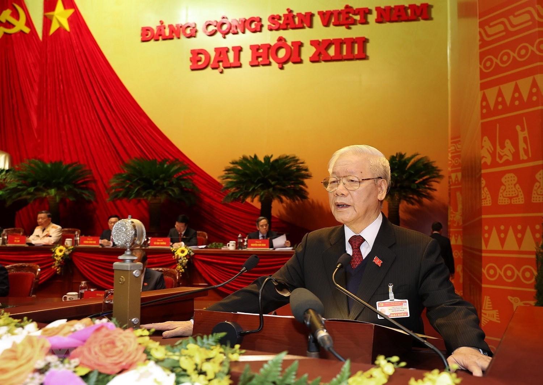 Đồng chí Nguyễn Phú Trọng, Tổng Bí thư Ban Chấp hành Trung ương Đảng, Chủ tịch nước CHXHCN Việt Nam trình bày Báo cáo Chính trị của Ban Chấp hành Trung ương Đảng khóa XII và các văn kiện trình Đại hội. (Ảnh: TTXVN)