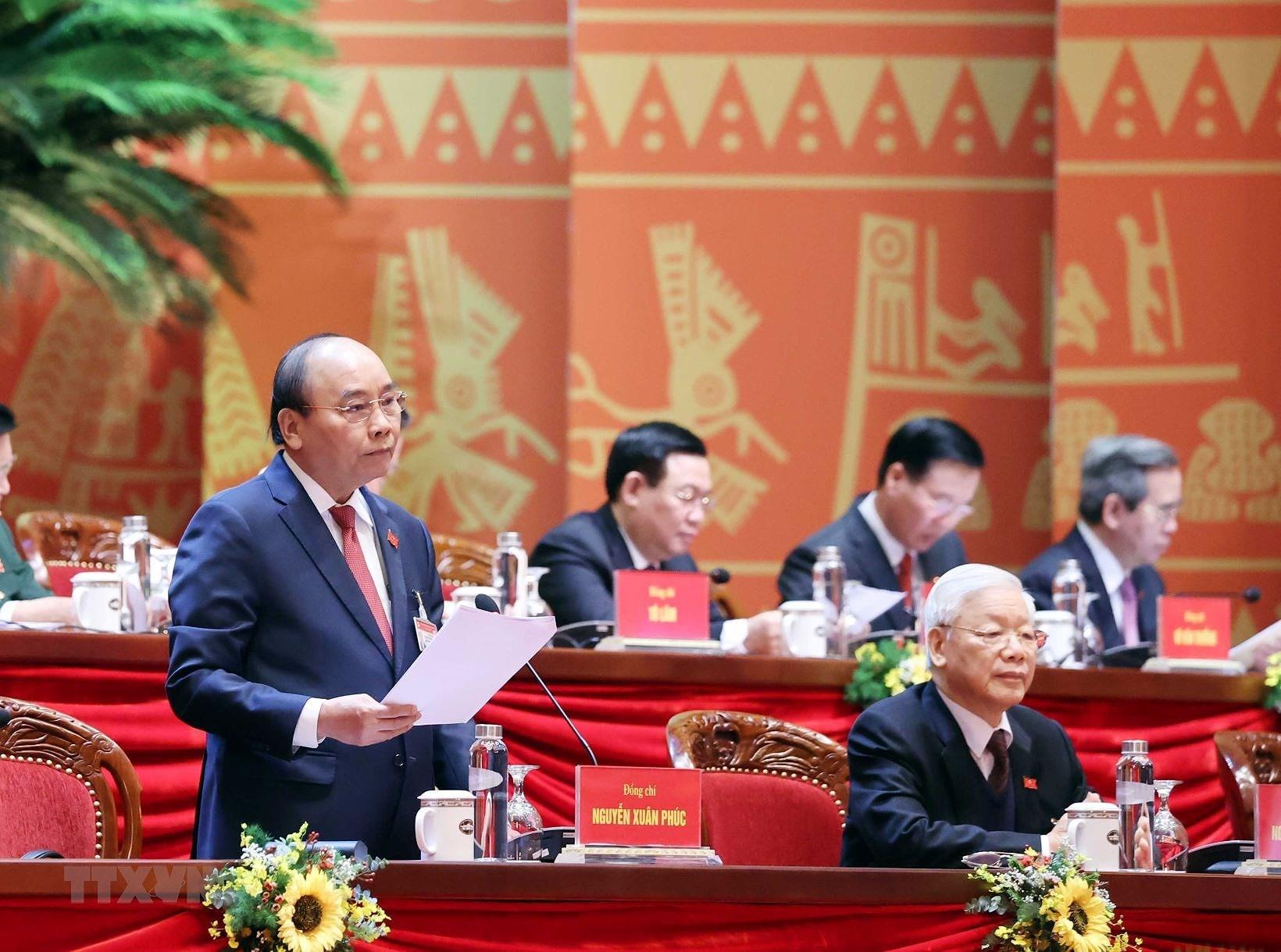 Thay mặt Đoàn Chủ tịch, đồng chí Nguyễn Xuân Phúc, Ủy viên Bộ Chính trị, Thủ tướng Chính phủ điều hành phiên thảo luận sáng 27/1 (Nguồn: TTXVN)