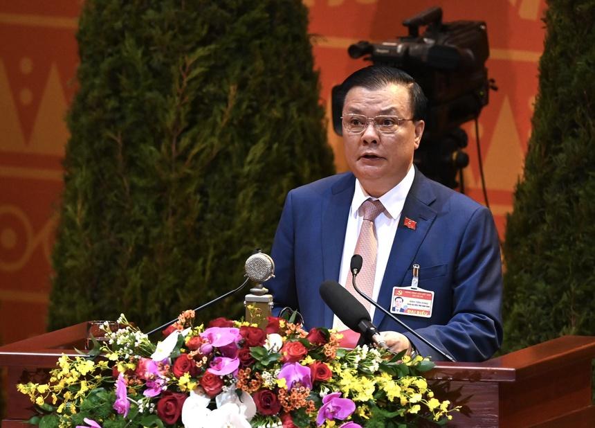 Bộ trưởng Bộ Tài chính Đinh Tiến Dũng trình bày tham luận tại Đại hội