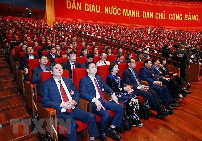 Đại biểu dự phiên thảo luận các văn kiện đại hội tại hội trường, sáng 28/1. (Ảnh: TTXVN)