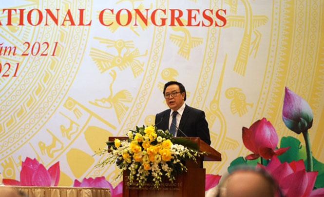 trưởng ban Đối ngoại Trung ương Đảng Hoàng Bình Quân thông báo kết quả Đại hội đại biểu toàn quốc lần thứ XIII của Đảng cho đoàn ngoại giao và các tổ chức quốc tế tại Hà Nội