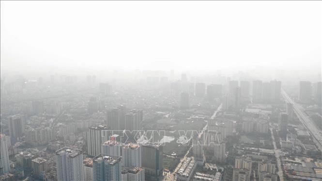 Hầu hết chỉ số chất lượng không khí ở Bắc Bộ đều ở mức màu đỏ, có hại cho sức khỏe. Ảnh tư liệu: TTXVN