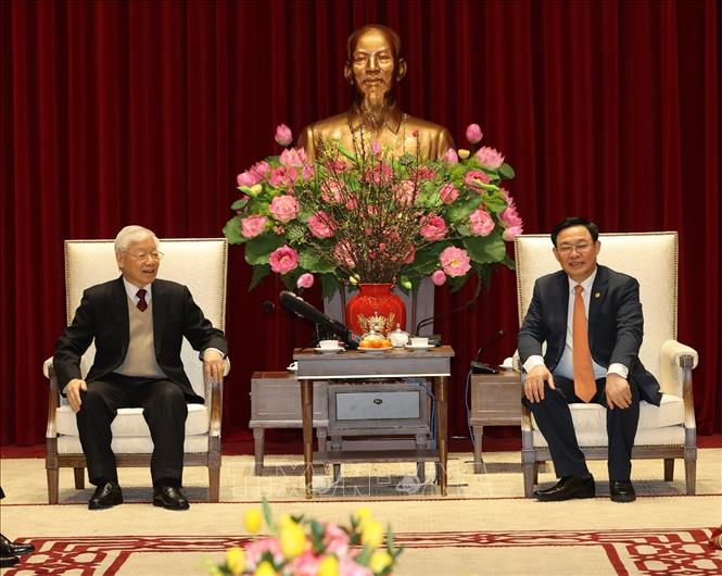 Tổng Bí thư, Chủ tịch nước Nguyễn Phú Trọng và đồng chí Vương Đình Huệ, Ủy viên Bộ Chính trị, Bí thư Thành uỷ Hà Nội. Ảnh: Trí Dũng/TTXVN