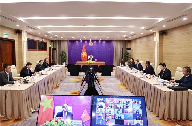 Chủ tịch nước Nguyễn Xuân Phúc và đoàn đại biểu Việt Nam tại điểm cầu Hà Nội. Ảnh: Thống Nhất/TTXVN