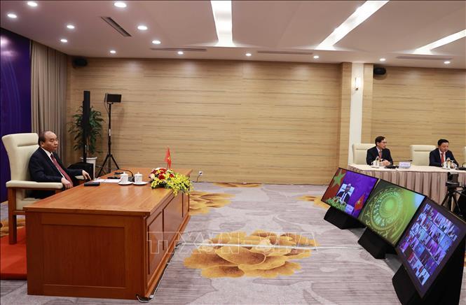 Chủ tịch nước Nguyễn Xuân Phúc tại điểm cầu Hà Nội. Ảnh: Thống Nhất/TTXVN