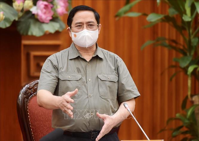 Thủ tướng Phạm Minh Chính yêu cầu các cơ quan, tổ chức, cá nhân thực hiện nghiêm hướng dẫn phòng, chống dịch COVID-19. Ảnh: TTXVN