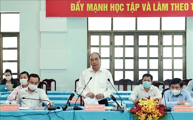 Chủ tịch nước Nguyễn Xuân Phúc, Chủ tịch Hội đồng Quốc phòng - An ninh phát biểu. Ảnh: Thống Nhất/TTXVN