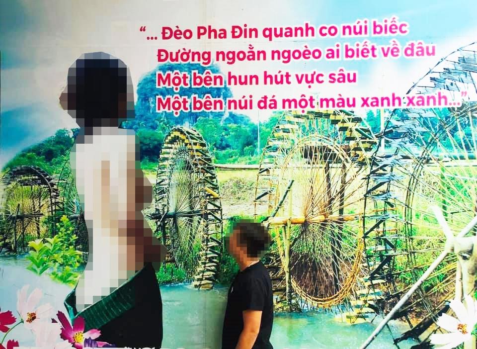 Tấm biển quảng cáo với hình ảnh cô gái mặc váy Thái phản cảm