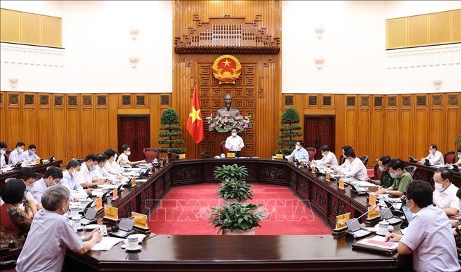 Quang cảnh cuộc họp Thường trực Chính phủ về công tác phòng, chống dịch COVID-19 chiều 17/5. Ảnh: Dương Giang/TTXVN
