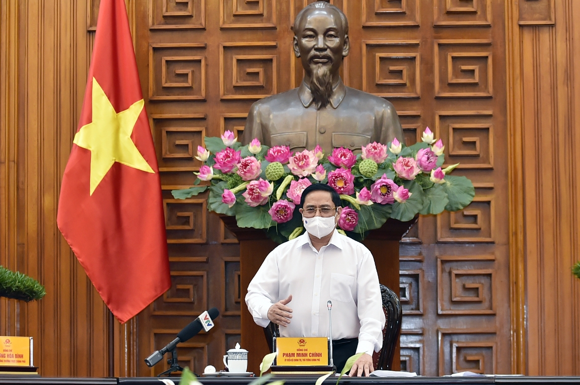 Thủ tướng Chính phủ Phạm Minh Chính phát biểu kết luận cuộc họp của Thường trực Chính phủ về phòng chống COVID-19, chiều 24/5. Ảnh: VGP/Nhật Bắc