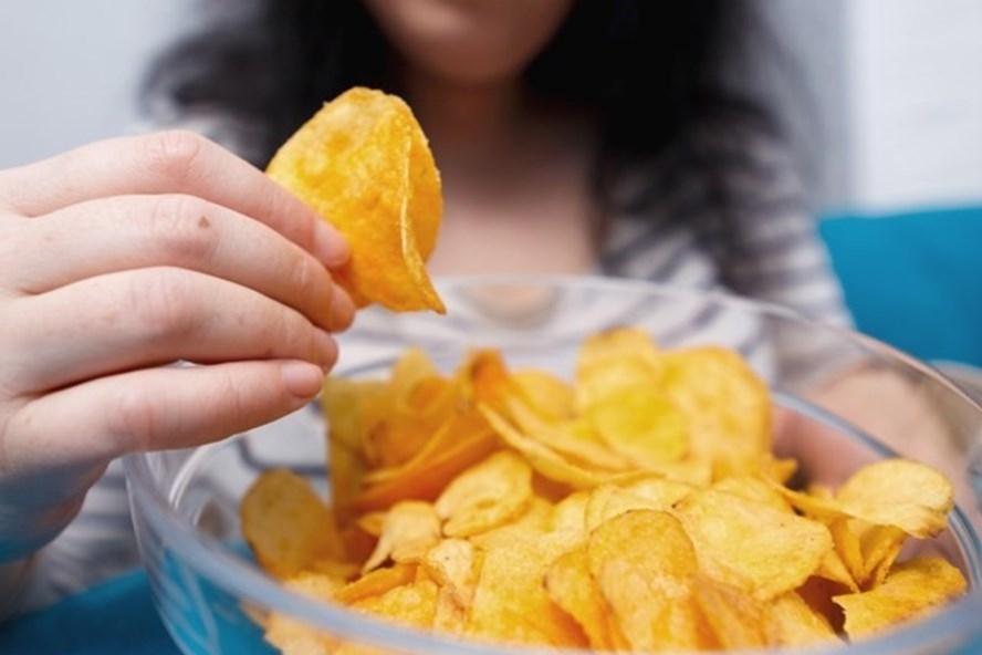 Ăn nhiều khoai tây chiên có thể là một trong những nguyên nhân khiến bạn nhanh lão hóa. Ảnh: AFP.