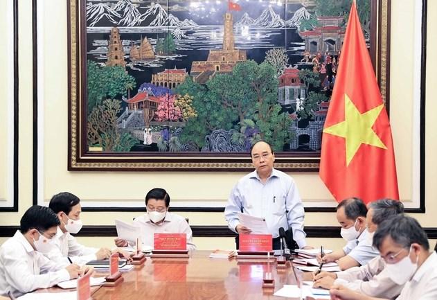 Chủ tịch nước Nguyễn Xuân Phúc phát biểu tại cuộc họp.