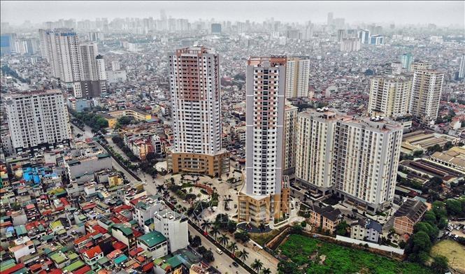 Theo các chuyên gia của Công ty Savills, tình trạng sốt đất đang dần lắng xuống nhưng giá trị bất động sản, đặc biệt là đất ở một số khu vực đã bị đẩy lên quá cao, có dấu hiệu giá ảo. Ảnh minh họa: Danh Lam/TTXVN