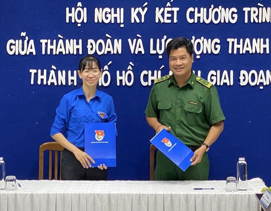 Ký kết Chương trình phối hợp giữa Thành đoàn và Lực lượng Thanh niên xung phong Thành phố Hồ Chí Minh giai đoạn 2020-2022, ngày 4/6/2020. (Ảnh: Hồng Giang/TTXVN)