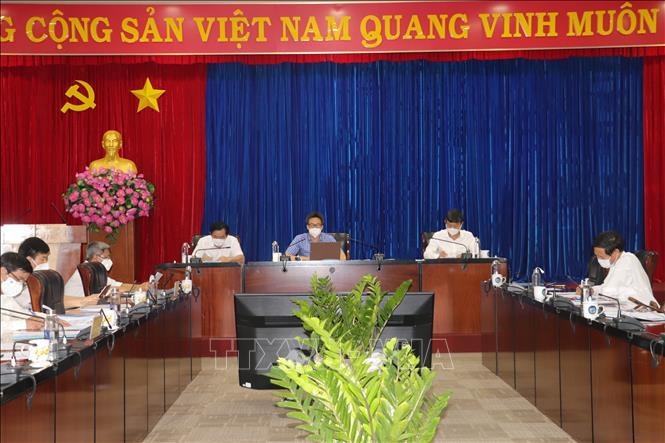Phó Thủ tướng Vũ Đức Đam làm việc với lãnh đạo tỉnh Bình Dương về công tác phòng, chống dịch COVID-19 trên địa bàn tỉnh. Ảnh: TTXVN