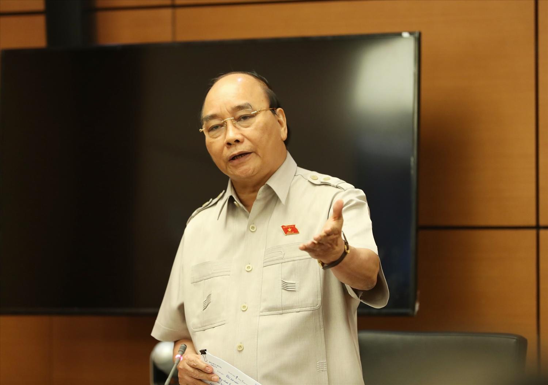Chủ tịch nước Nguyễn Xuân Phúc nhận định, việc đời sống cả vật chất và tinh thần của người dân được cải thiện rõ rệt là một trong những thành quả quan trọng nhất. Ảnh: VGP/Hải Liên