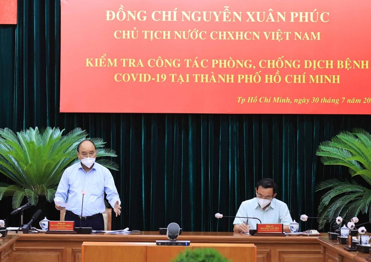 Chủ tịch nước Nguyễn Xuân Phúc làm việc với lãnh đạo chủ chốt TPHCM - Ảnh: VGP