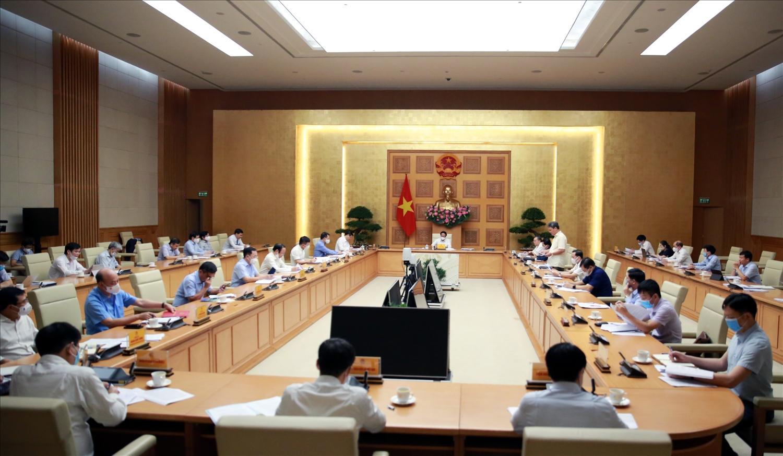 Phó Chủ nhiệm Văn phòng Chính phủ Nguyễn Cao Lục công bố quyết định của Thủ tướng Chính phủ về kiện toàn Ban Chỉ đạo Quốc gia về phát triển điện lực - Ảnh VPG/Đức Tuân