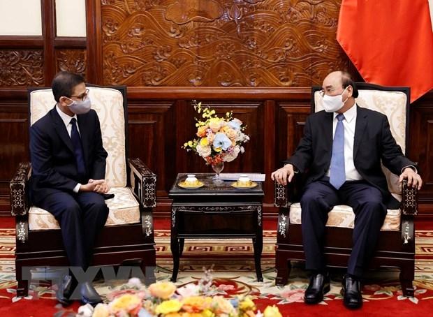 Chủ tịch nước Nguyễn Xuân Phúc và Đại sứ Ấn Độ Verma tại buổi tiếp. (Ảnh: Thống Nhất/TTXVN)