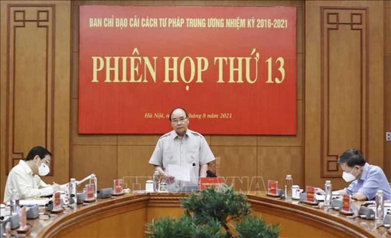 Chủ tịch nước Nguyễn Xuân Phúc phát biểu tại Phiên họp thứ 13 Ban Chỉ đạo Cải cách tư pháp Trung ương, sáng 26/8. (Ảnh: TTXVN)