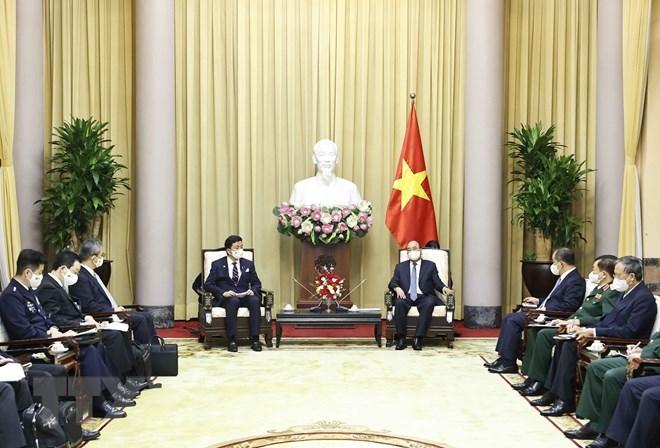 Chủ tịch nước Nguyễn Xuân Phúc tiếp Bộ trưởng Quốc phòng Nhật Bản Kishi Nobuo đang thăm và làm việc tại Việt Nam, sáng 12/9. Ảnh: TTXVN