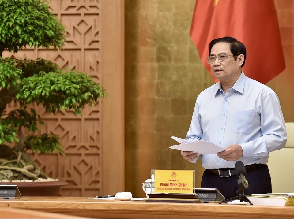 """Thủ tướng Phạm Minh Chính: Với sự chung sức, đồng lòng của toàn Đảng, toàn dân, toàn quân """"triệu trái tim, một ý chí"""", sự ủng hộ, giúp đỡ của đồng bào ta ở nước ngoài và cộng đồng quốc tế, nhất định chúng ta sẽ sớm chiến thắng đại dịch COVID-19 - Ảnh: VGP/Nhật Bắc"""