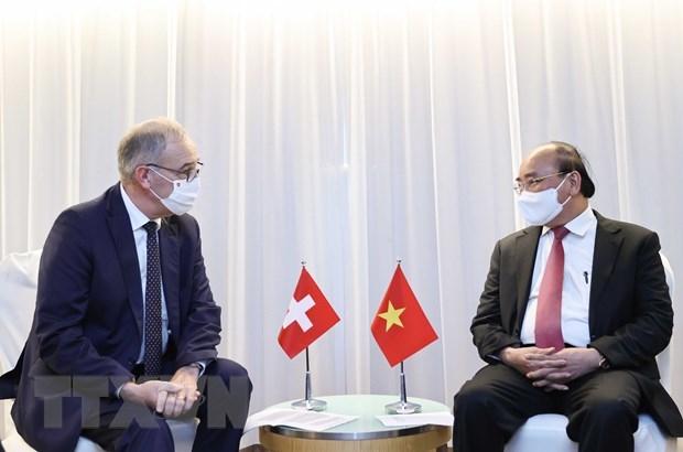 Chủ tịch nước Nguyễn Xuân Phúc gặp Tổng thống Thụy Sỹ Guy Parmelin. (Ảnh: Thống Nhất/TTXVN)