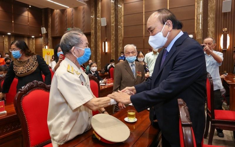 Chủ tịch nước Nguyễn Xuân Phúc với các đại biểu tại buổi lễ. (Ảnh: Duy Linh)