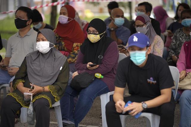 Tại Malaysia, việc tiêm mũi tăng cường sẽ không bắt buộc. (Ảnh: AP)